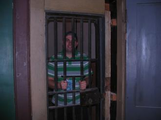 Jon Kitchen looking oddly at home inside a locked prison cell