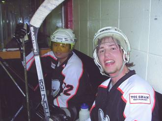 Kent Chow and Steven Pelser sitting on the bench during a Calgary Phantoms inline hockey game