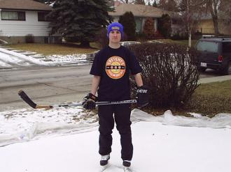 Me (Ryan Hellyer) playing hockey on our front lawn