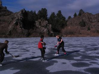 Nick, Ben and Stephanie playing pond hockey on the Manorburn dam