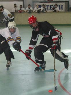 Stu McLennan trying to get the puck off a Redback