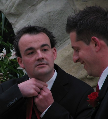 Nick (right) laughing at Leigh's attempts to tie a tie
