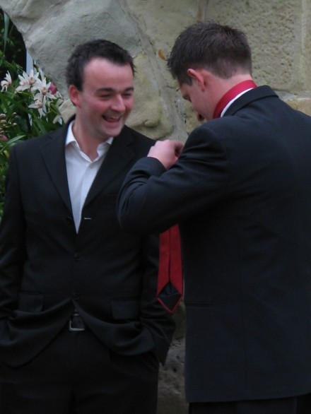 Leigh (left) stoked he got Nick to tie his tie without anyone noticing ...