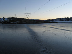 The power lines hanging over the Idaburn dam dropped annoying amounts of frost onto the ice.