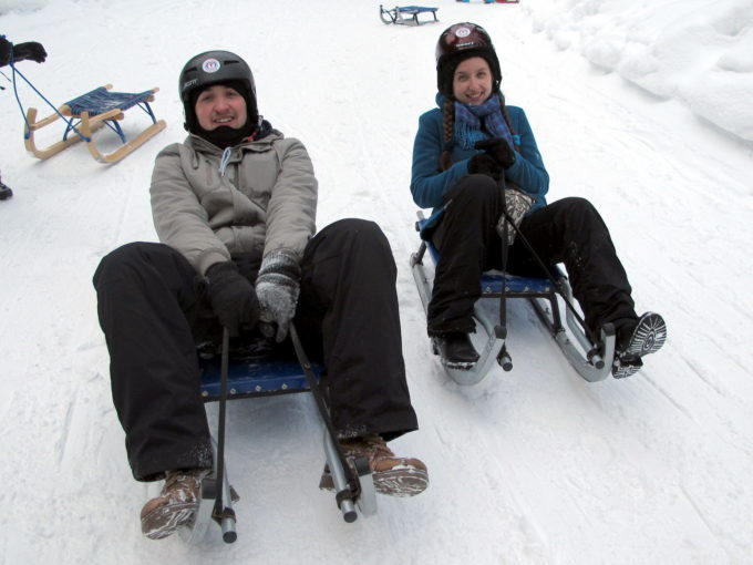 Boban and Ivelina sledding at Korketrekkeren