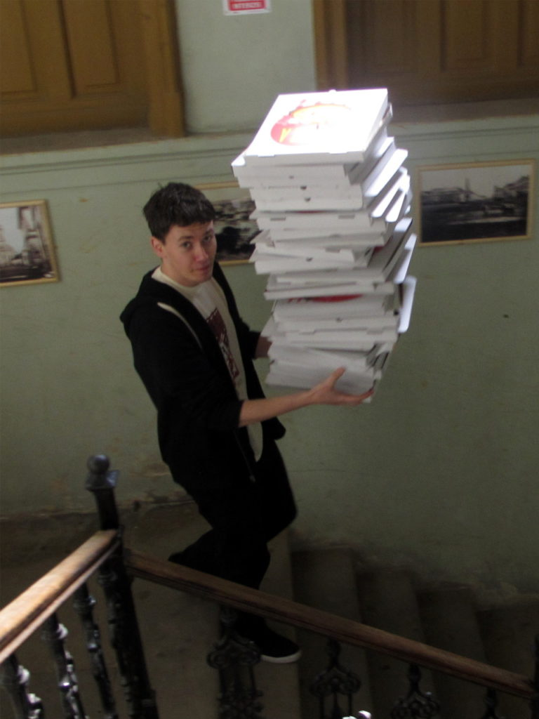 Scribu, aka Cristi Burcă, discarding the pizzas on hack day.
