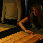 Beth playing shuffleboard