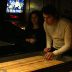 Mark playing shuffleboard