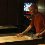 Ryan Hellyer playing shuffleboard